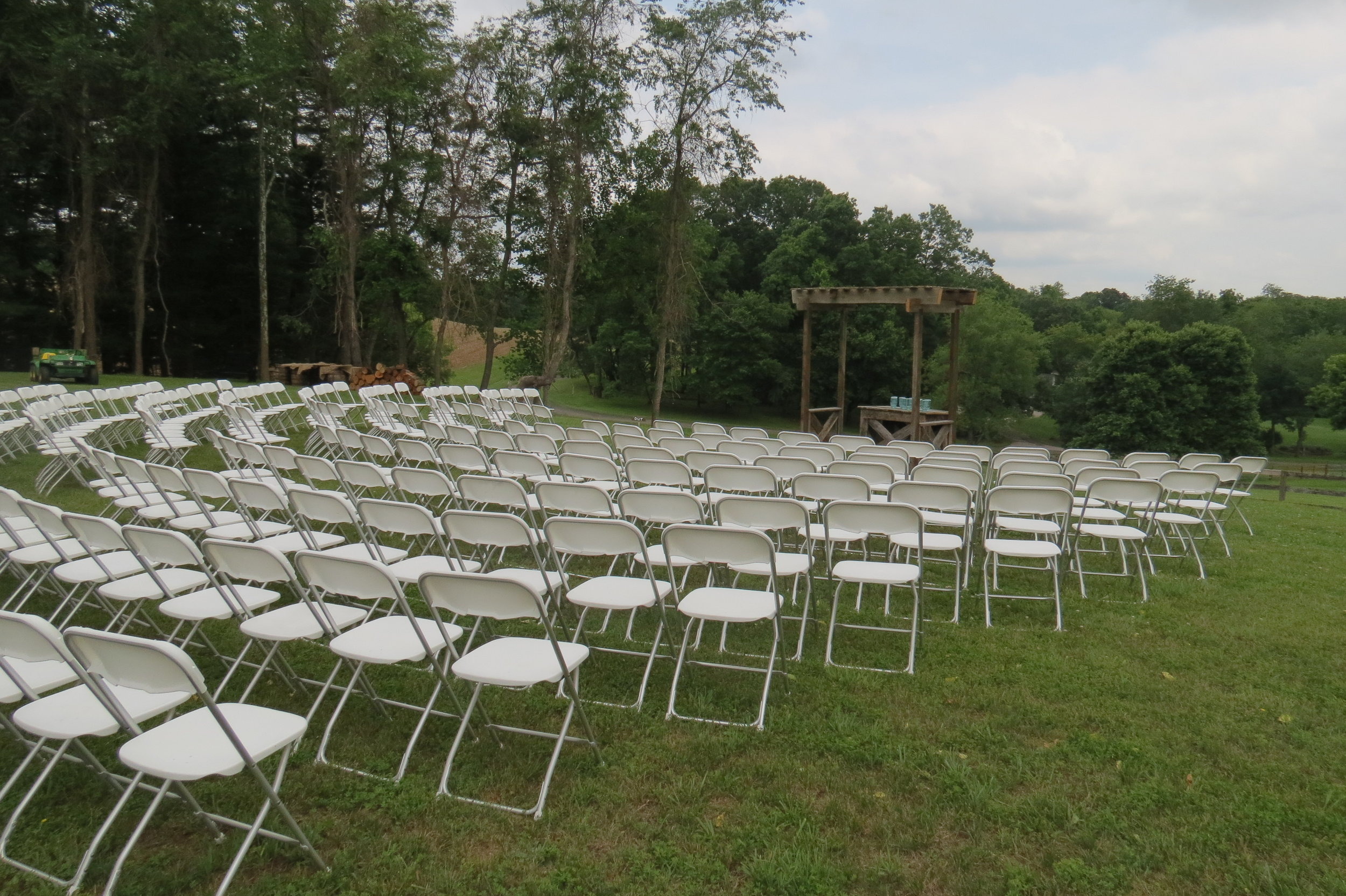 White folding chairs to rent for your outdoor ceremony