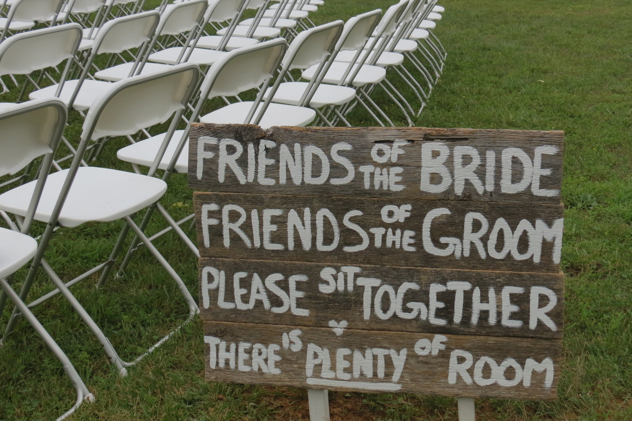White folding chairs for your outdoor ceremony