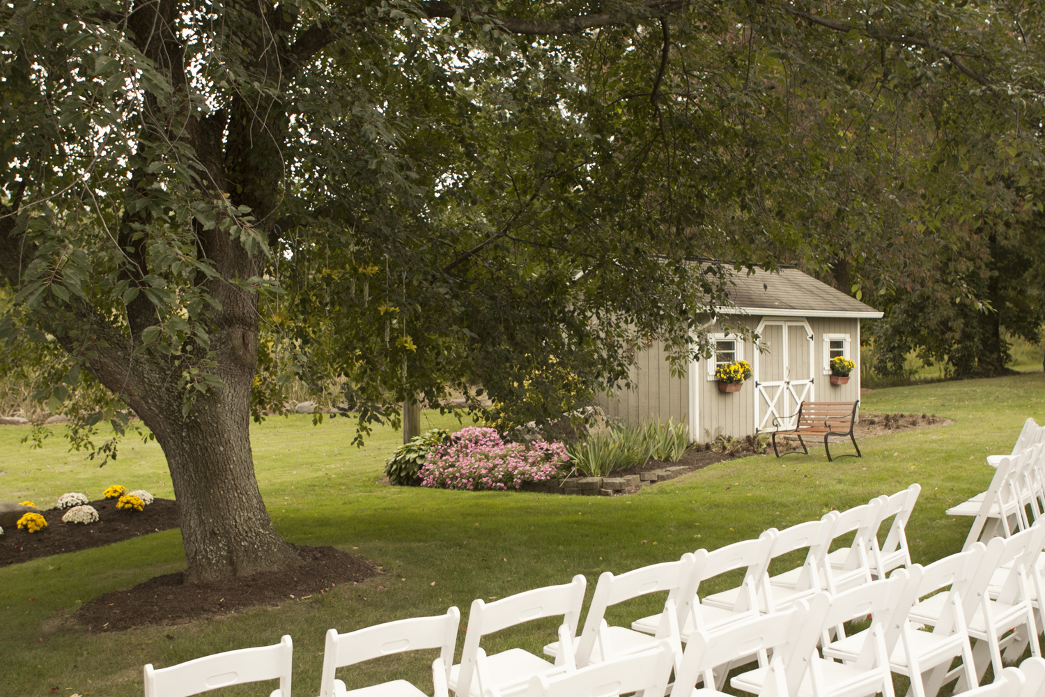 White padded folding chairs for your outdoor wedding ceremony
