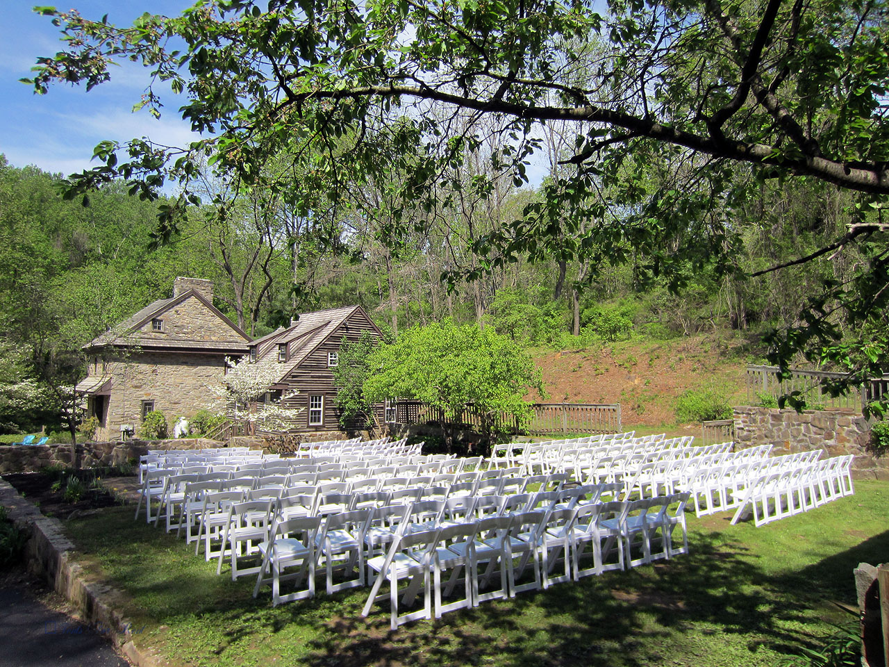 White padded folding garden chairs for your outdoor ceremony