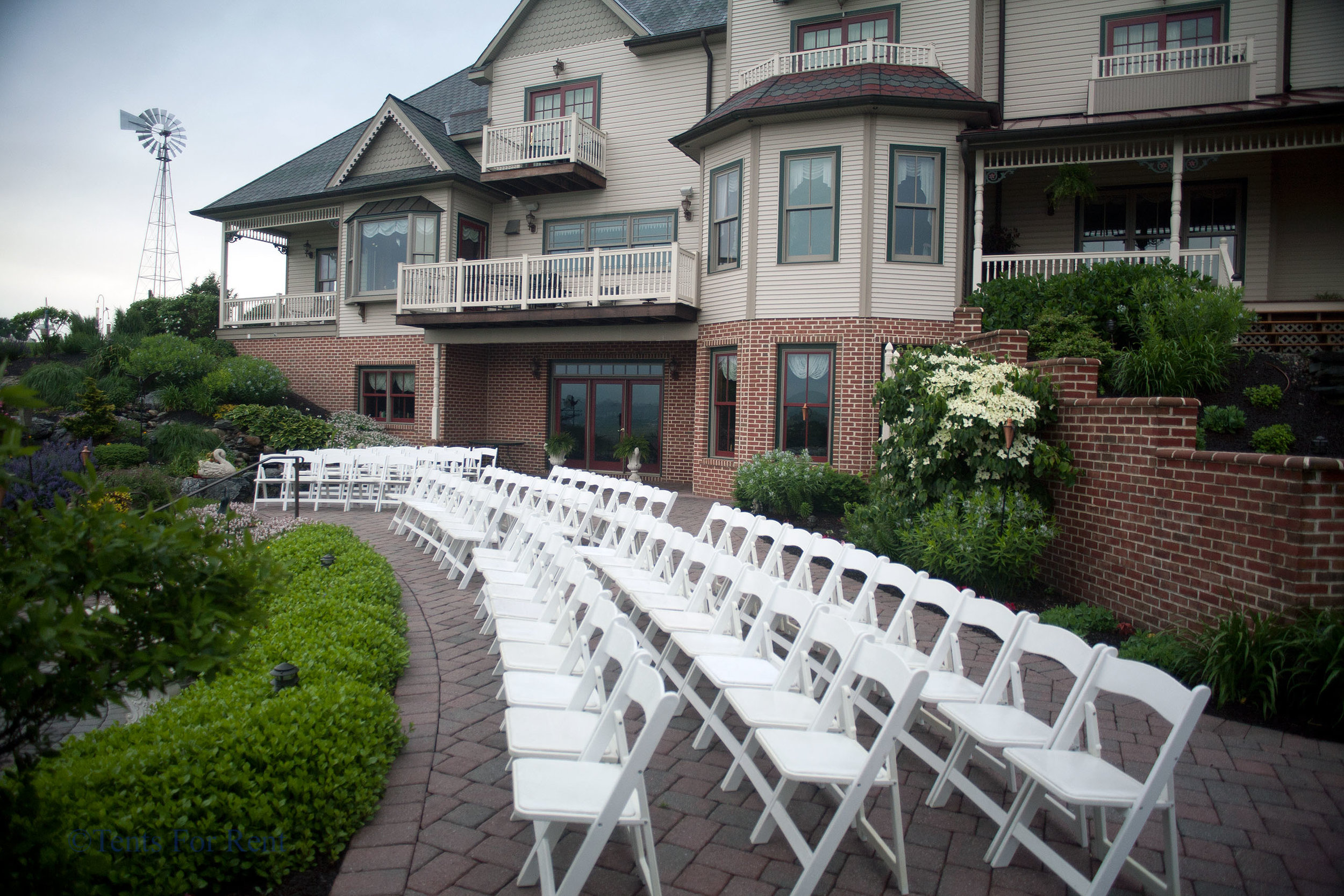 White padded folding garden chairs for your outdoor event