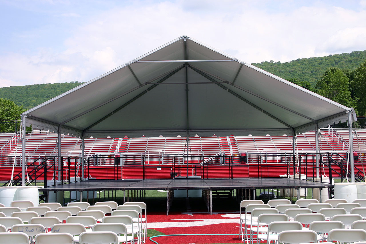 Outdoor college commencement stage and tent