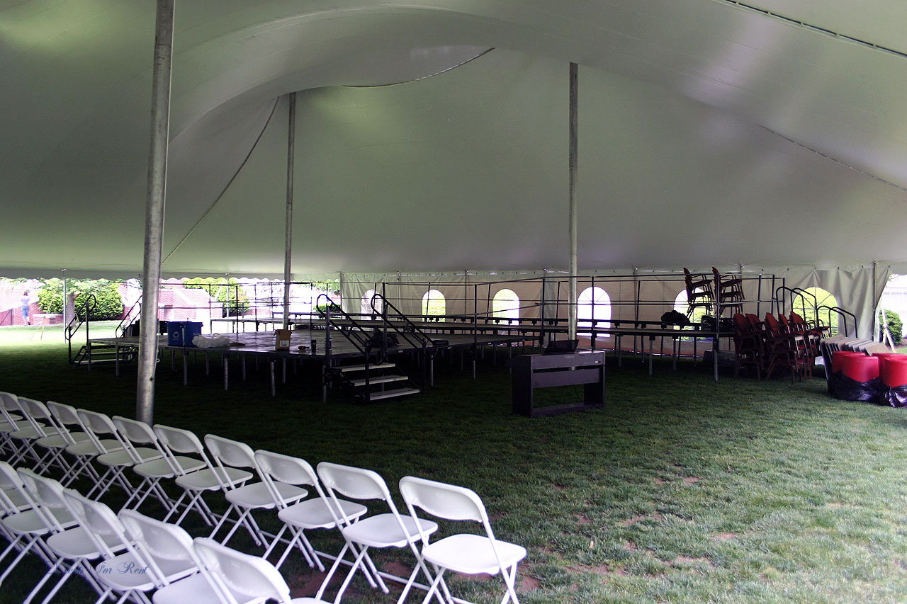 College graduation chairs, stage and tent