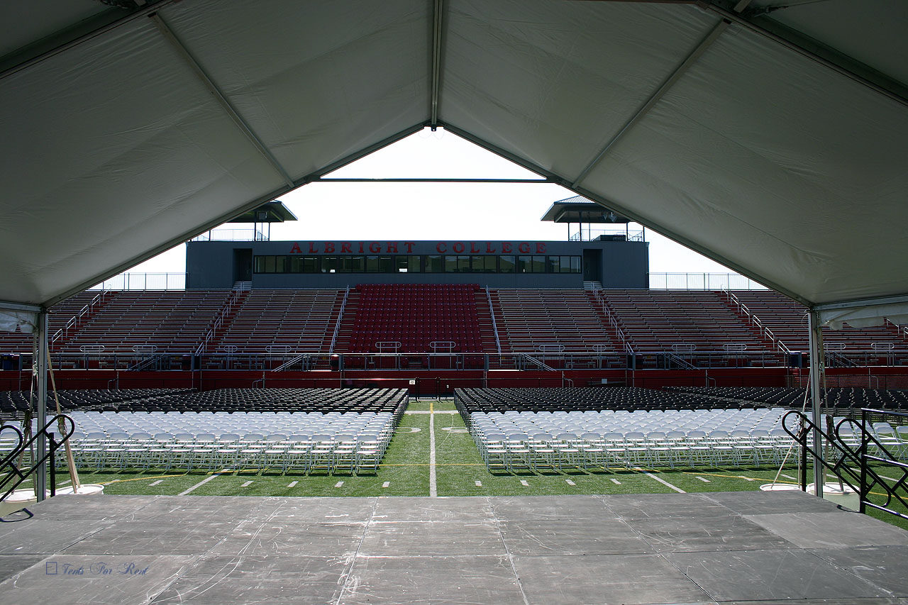 College graduation stage and tent