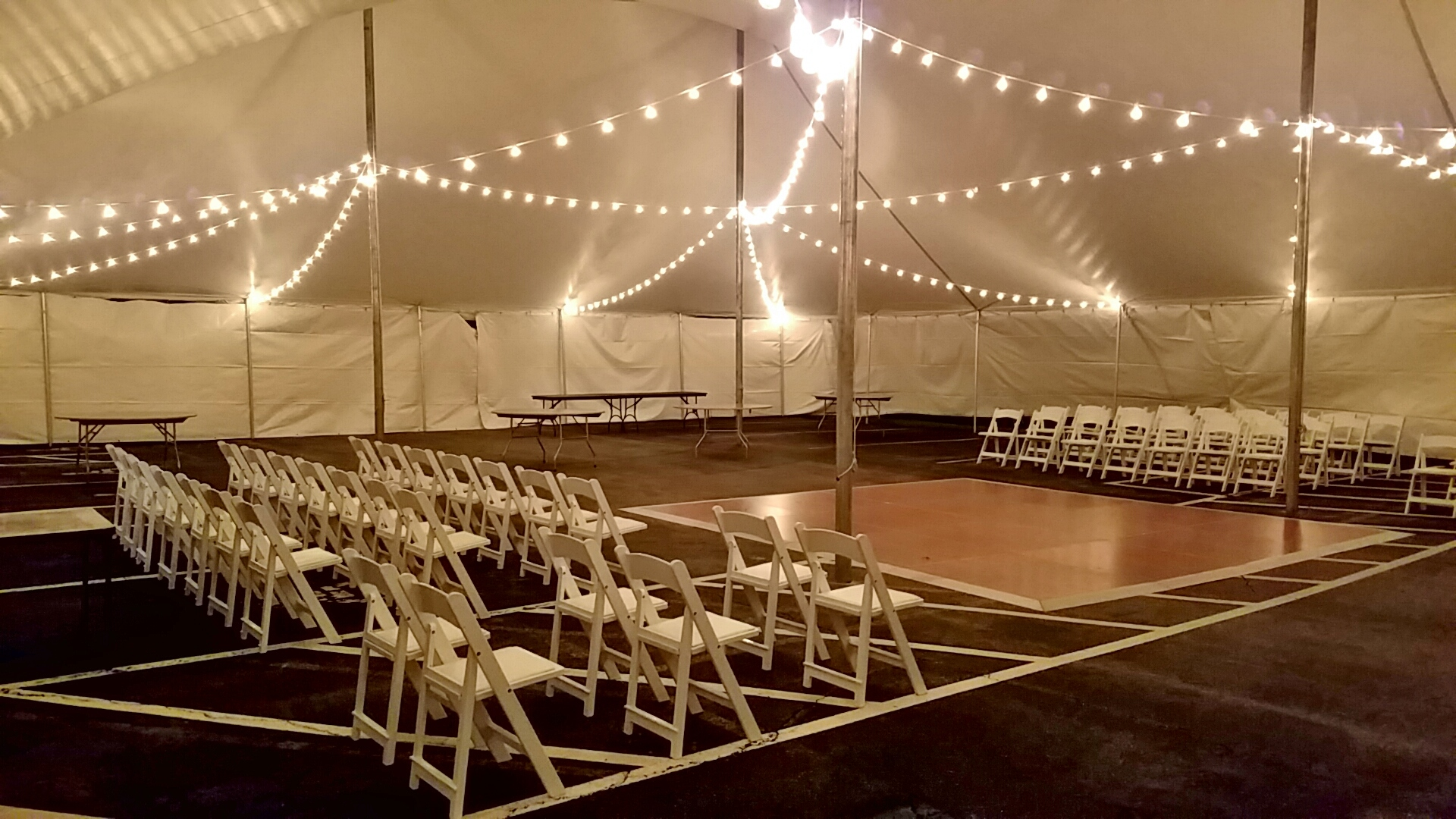 White padded garden chairs, dance floor and cafe lighting for rent in Chester, PA