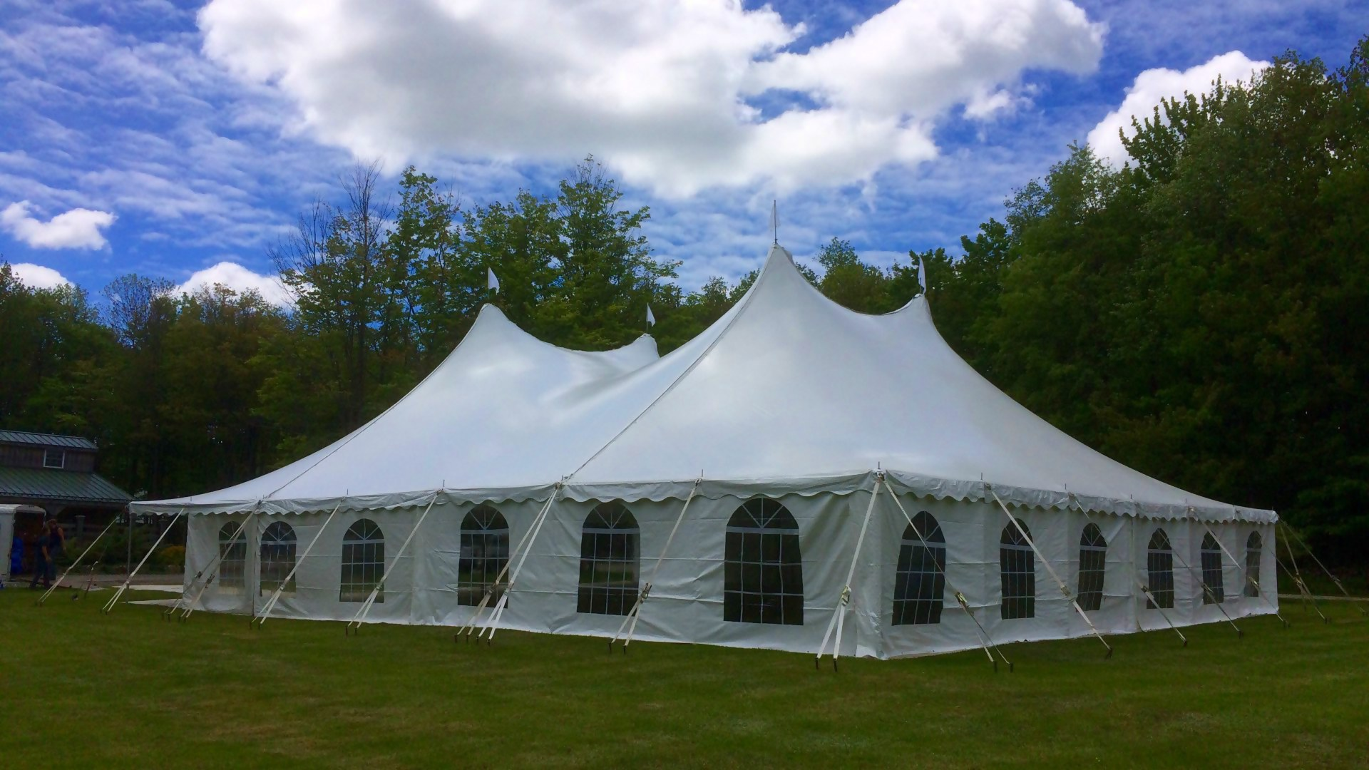 Large white tent with cathedral window sidewalls for rent in Coatesville, PA