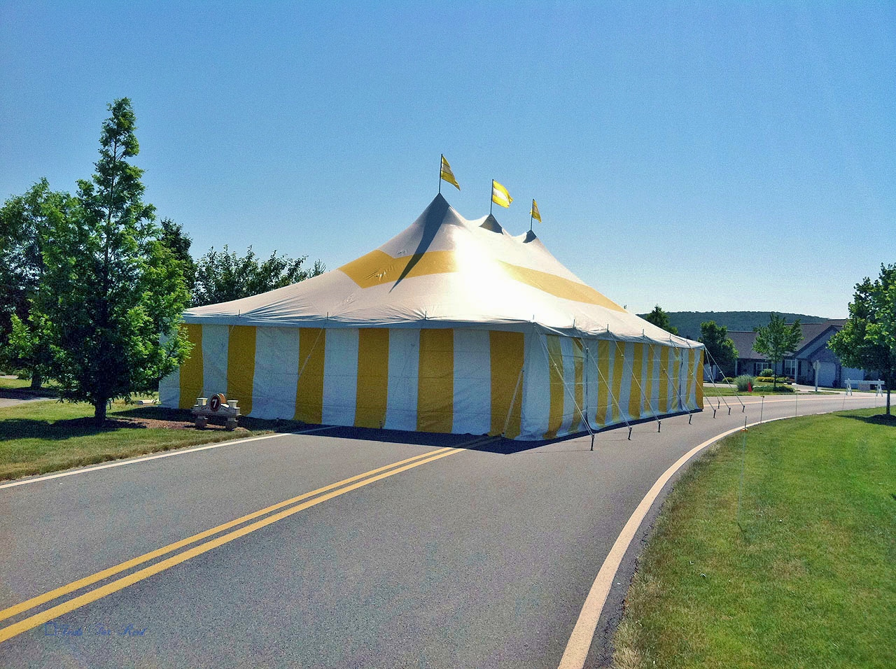 Nice yellow party tent with matching sidewalls for rent in Chambersburg, PA