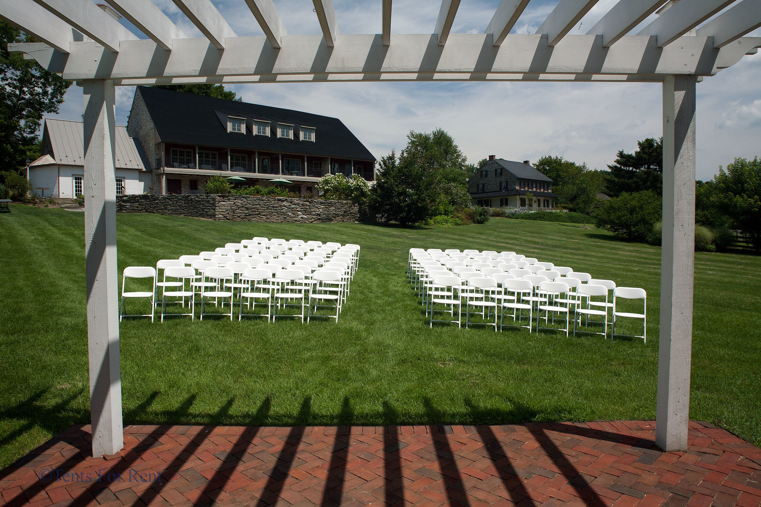 Comfortable white folding chairs for rent in Radnor, PA
