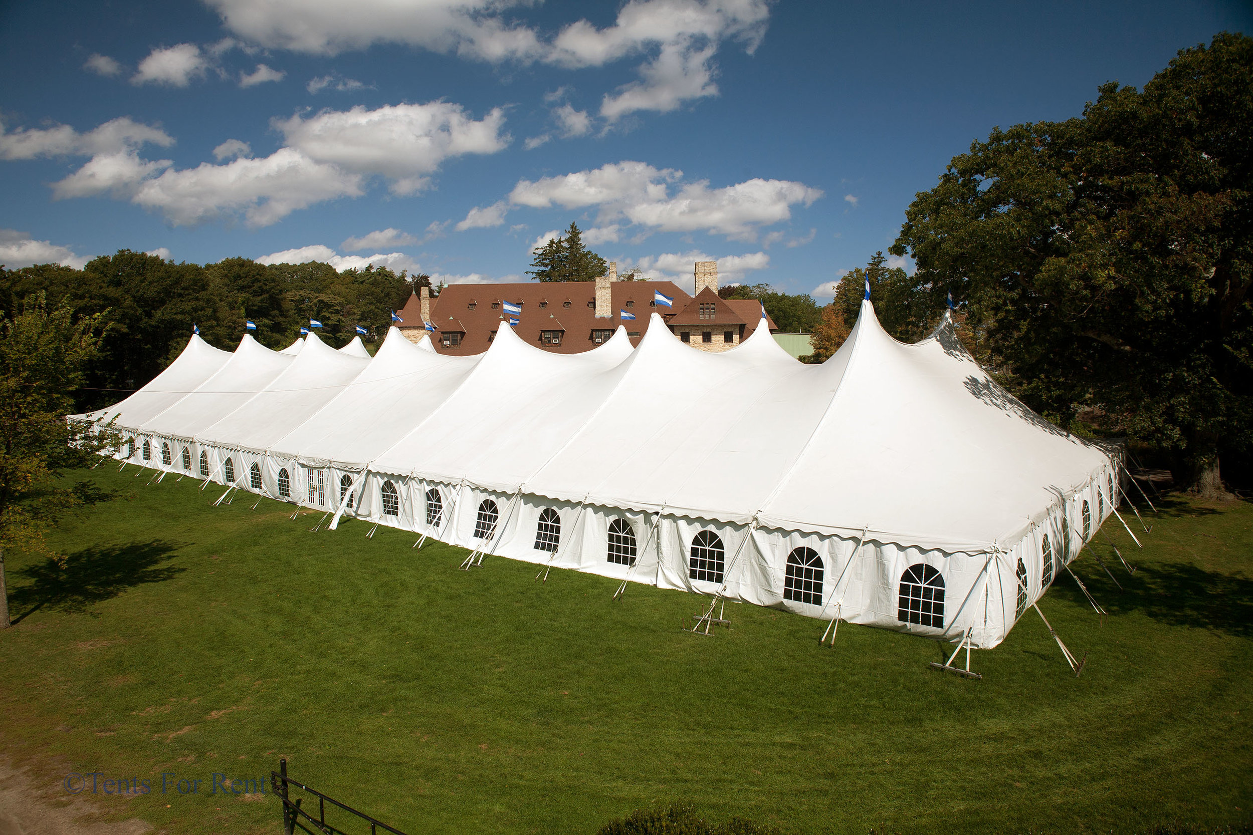 Large white pole tent with cathedral window sidewalls for rent in Kennett Square, PA