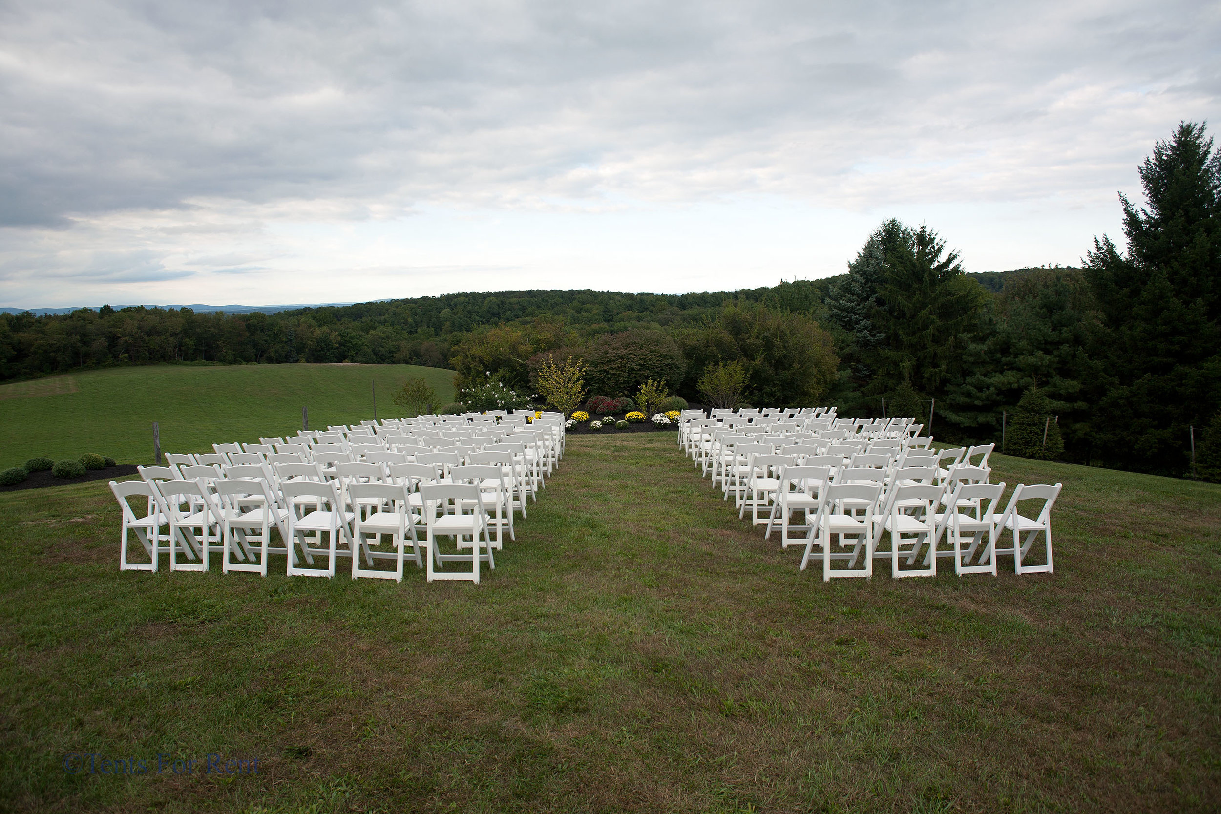 Comfortable white padded garden chairs for rent in Kennett Square, PA