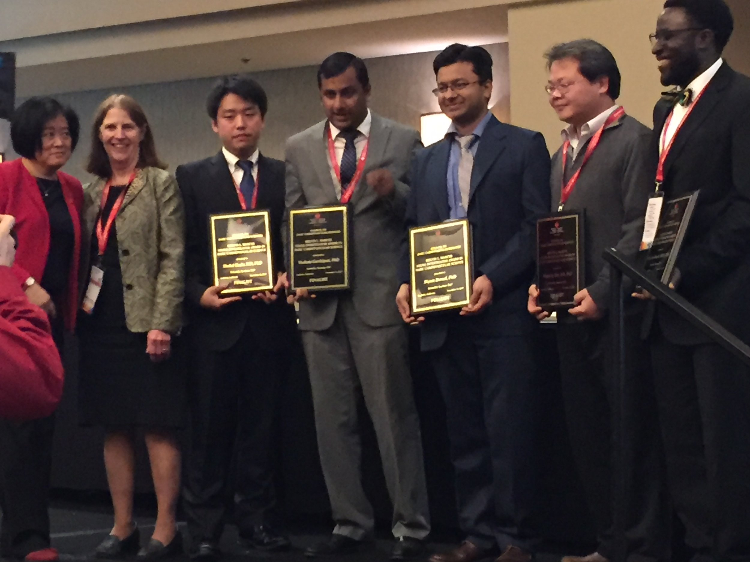 Dr. Ikeda (third from right) holding his finalist plaque.