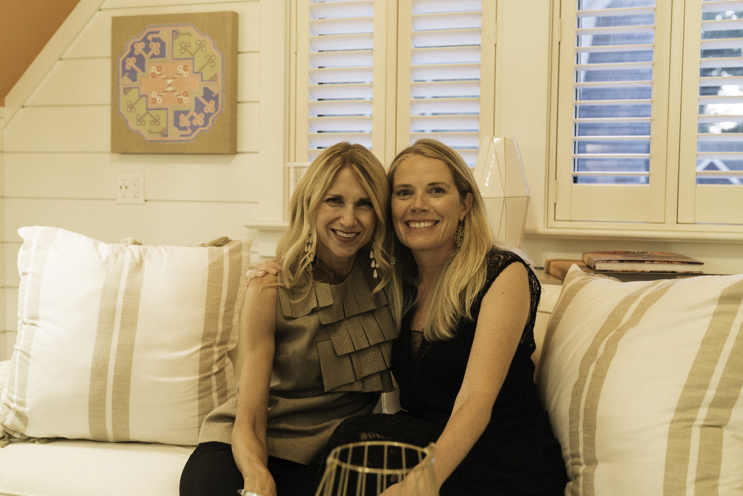Gallerist Jessica Hagen and Collector Kristen Connell in the VIP guest quarters (left to right) with a painting by James Steele