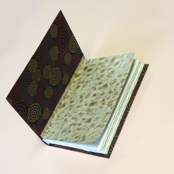 reduced open book with swirls on inside.jpg
