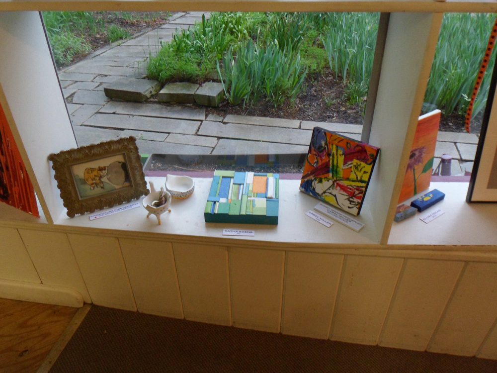 reduced Artwork in window Khwanchira Katha Soens Carol Miller.jpg