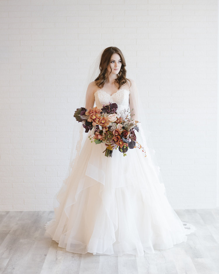 Visit our bridal shops in Edmonton and Calgary to see this wedding dress in person. -