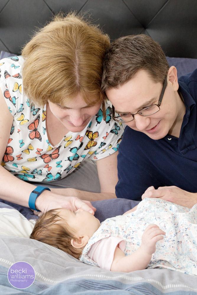 Baby Photographer Hemel Hempstead - family on bed