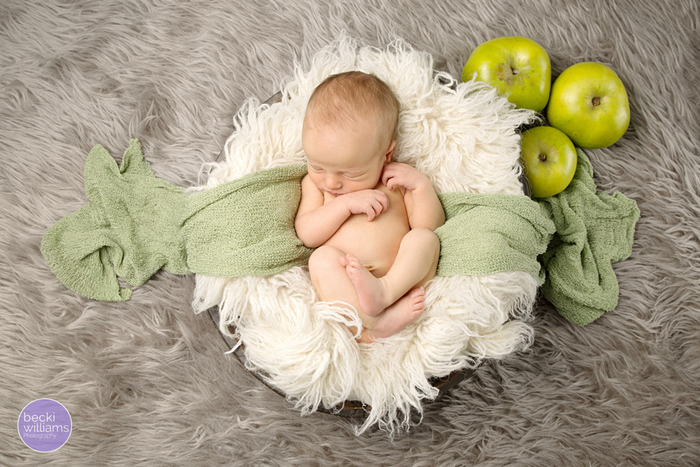 Newborn photos St Albans - apples, fluff, green