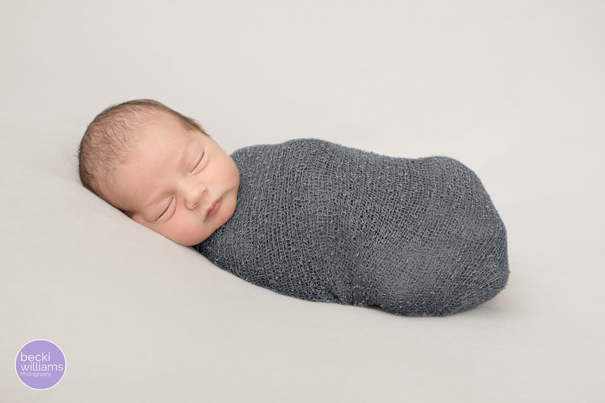 wrapped up newborn baby