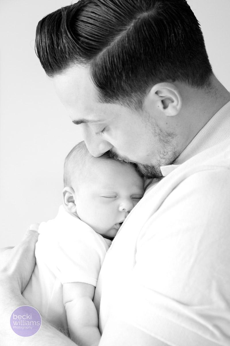 BABY PICS HEMEL HEMPSTEAD - dad cuddles baby boy - black and white