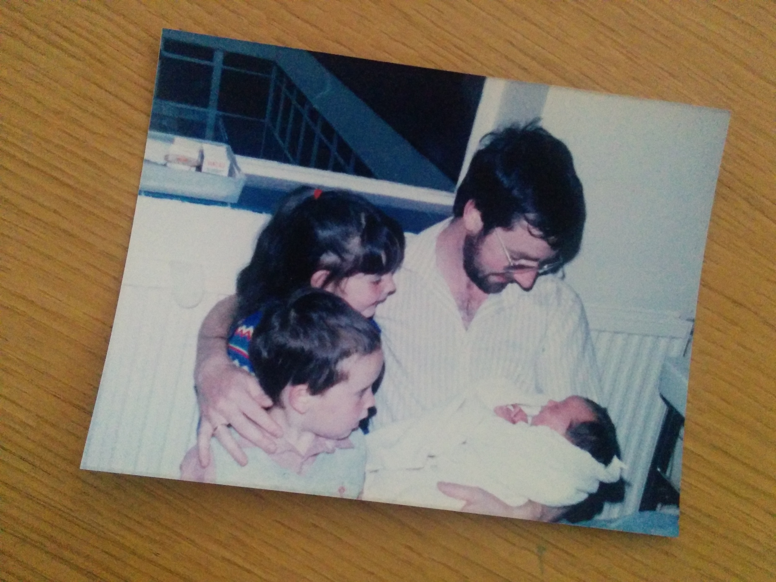 my dad, sister & brother holding me in the hospital right after i'd been born #existinphotos