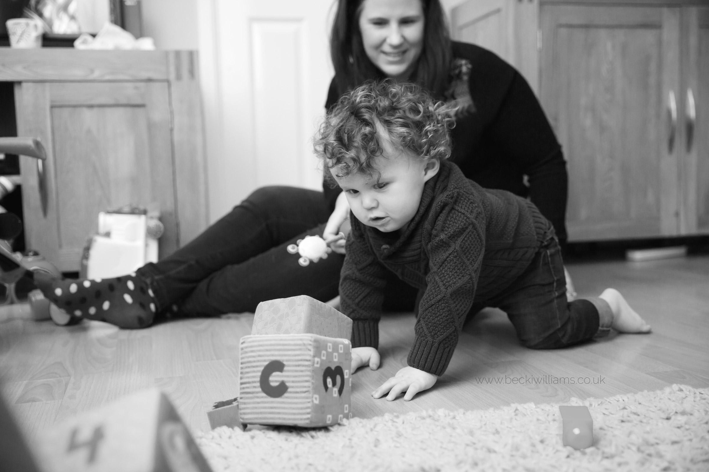 family-photographer-hemel-hempstead-playing-toys-natural
