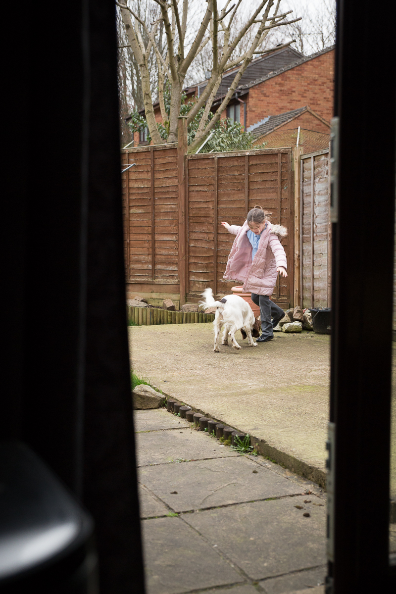Girl playing in the garden with a dog