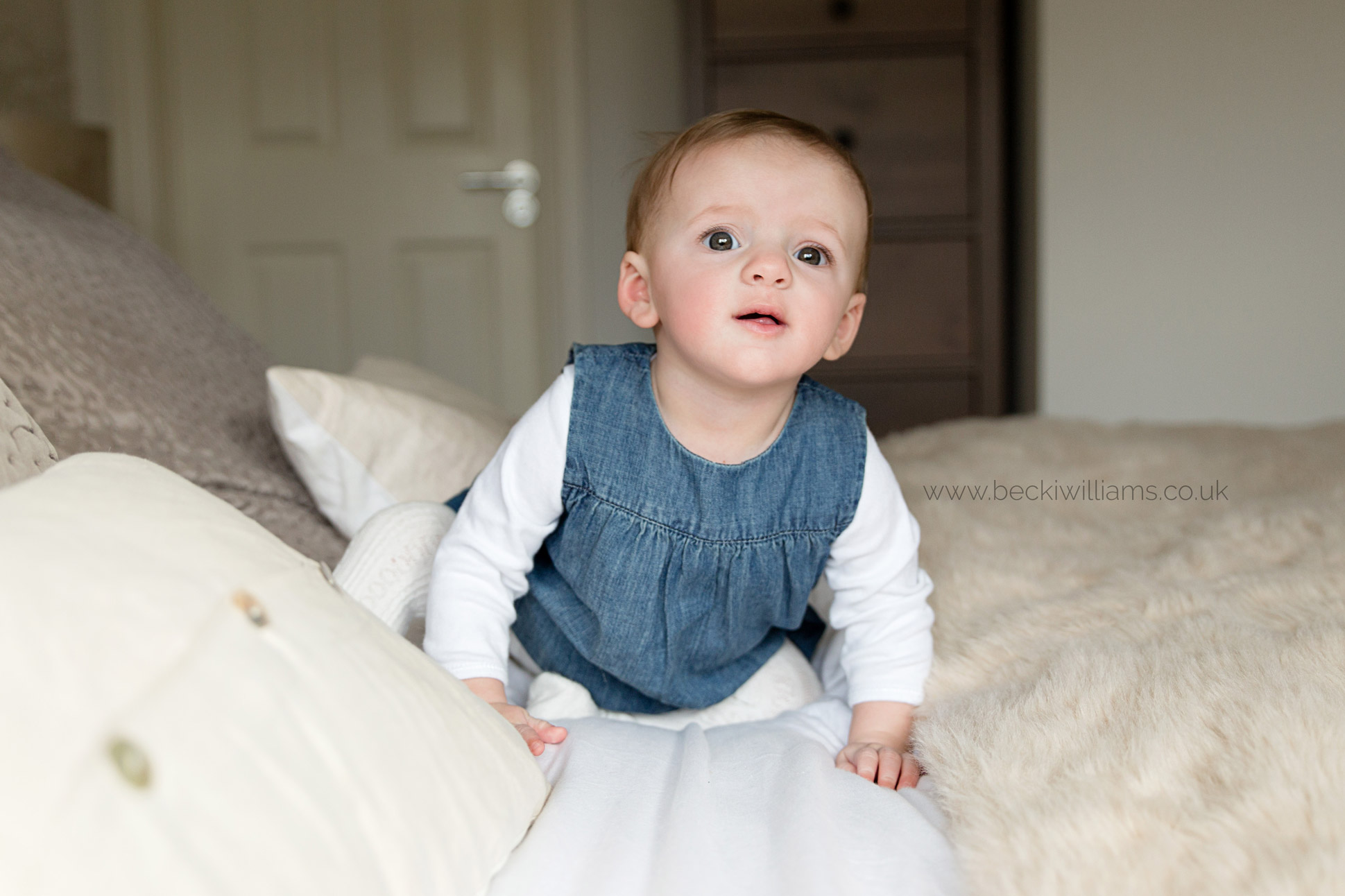 family-photographer-hemel-hempstead-8-month-old-baby-on-bed