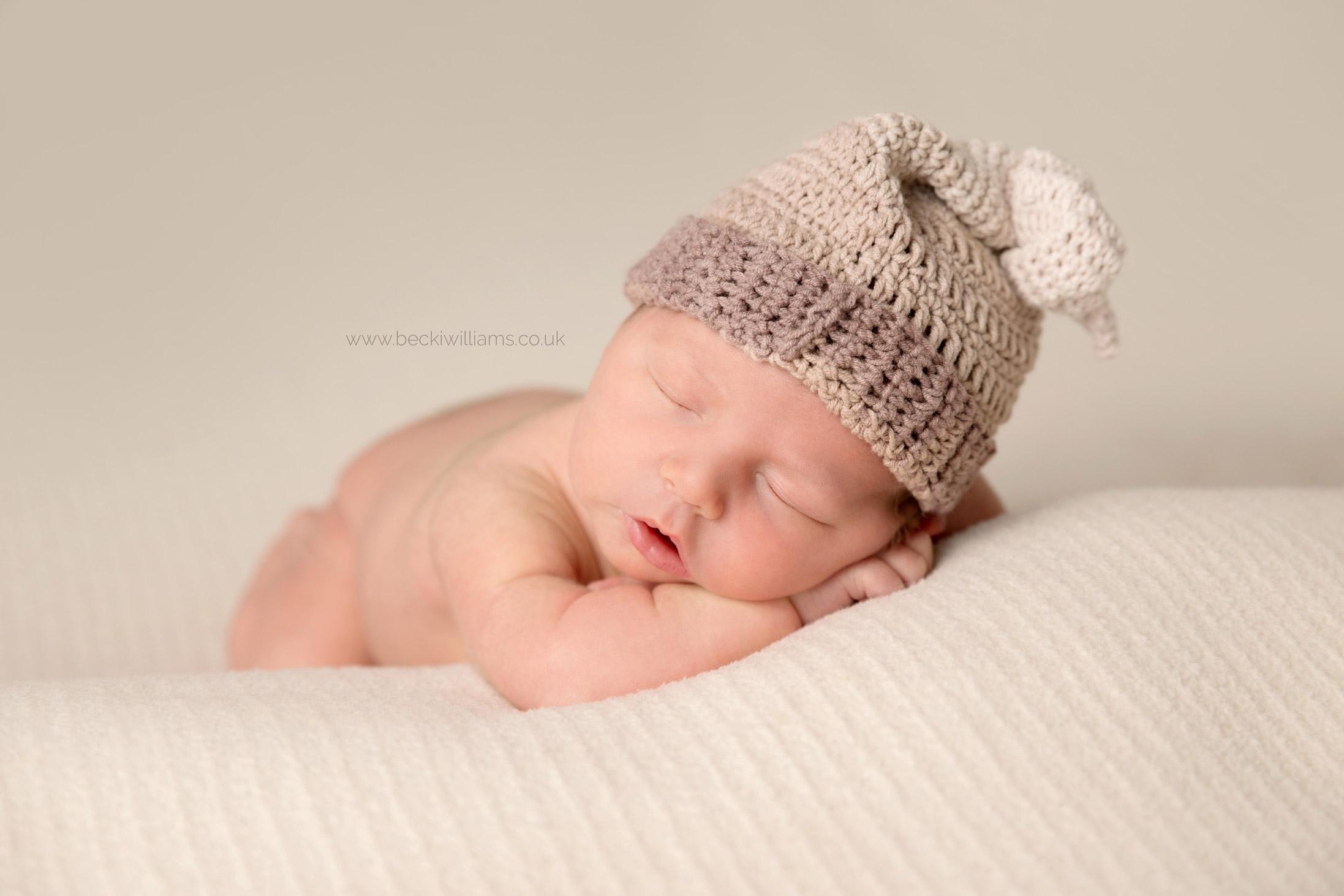Newborn Photography hemel hempstead - sleeping baby - hat or not hat