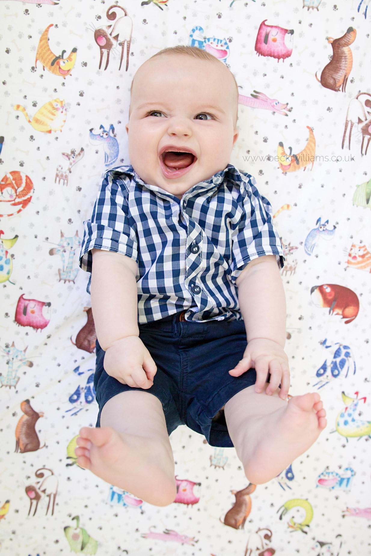Baby-Photography-Hemel-Hempstead-Happy-In-Cot