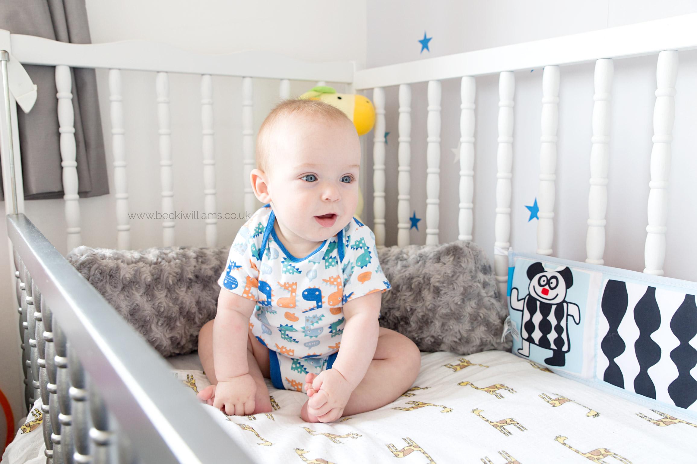 Baby-photography-hemel-hempstead-baby-sitting-in-cot