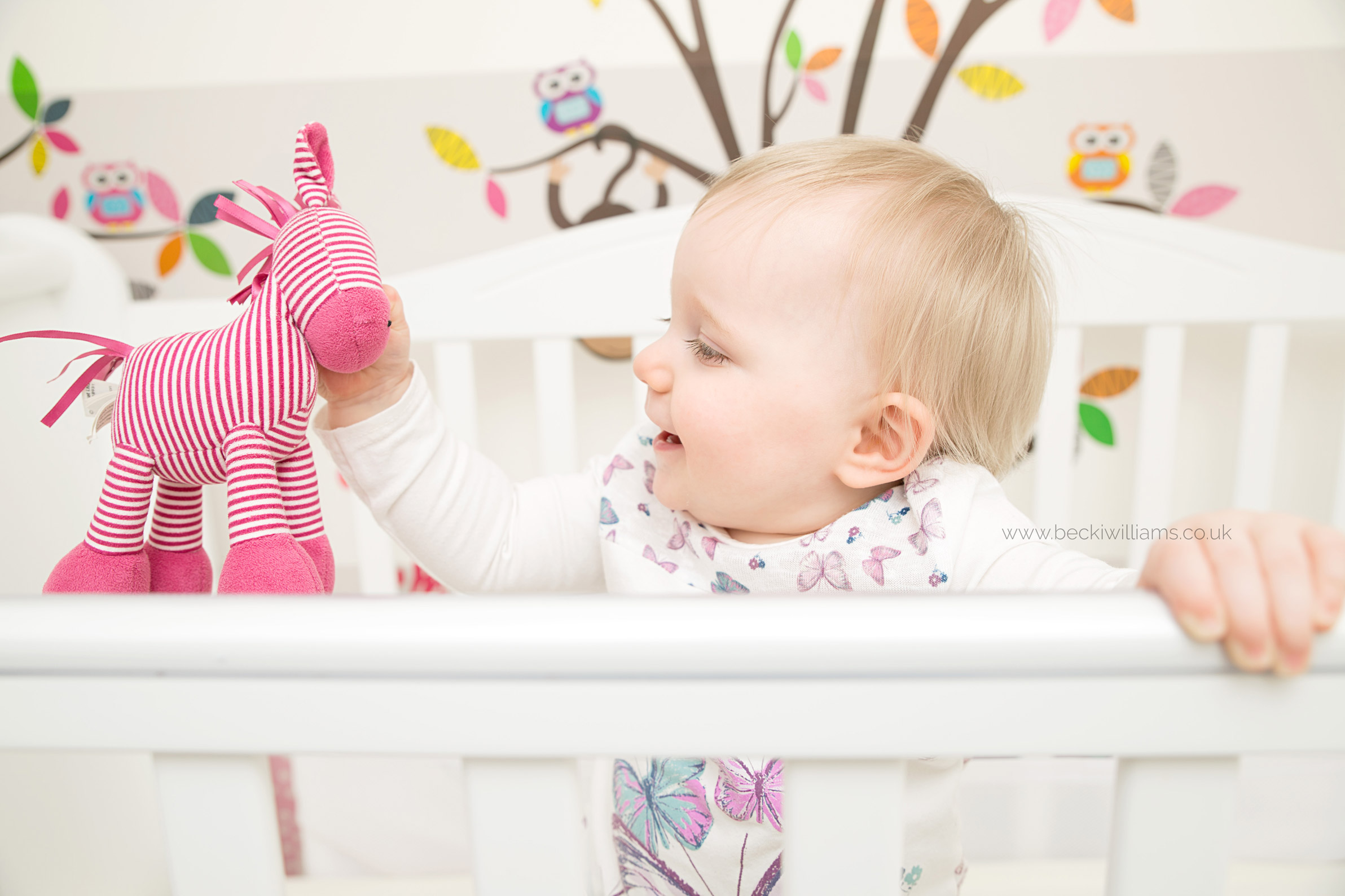 baby-photography-hemel-hempstead-playing-in-cot-at-home-relaxed