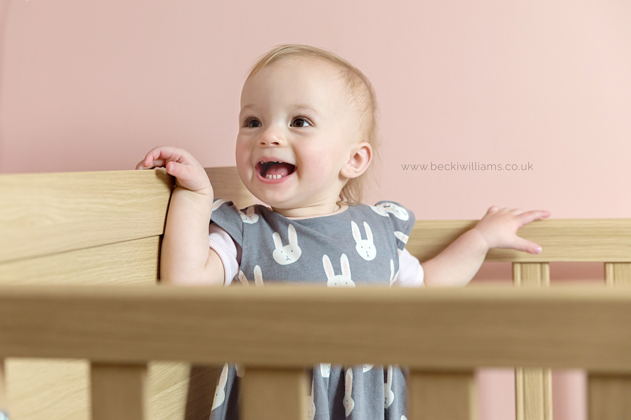 1 year old laughing in her cot in luton