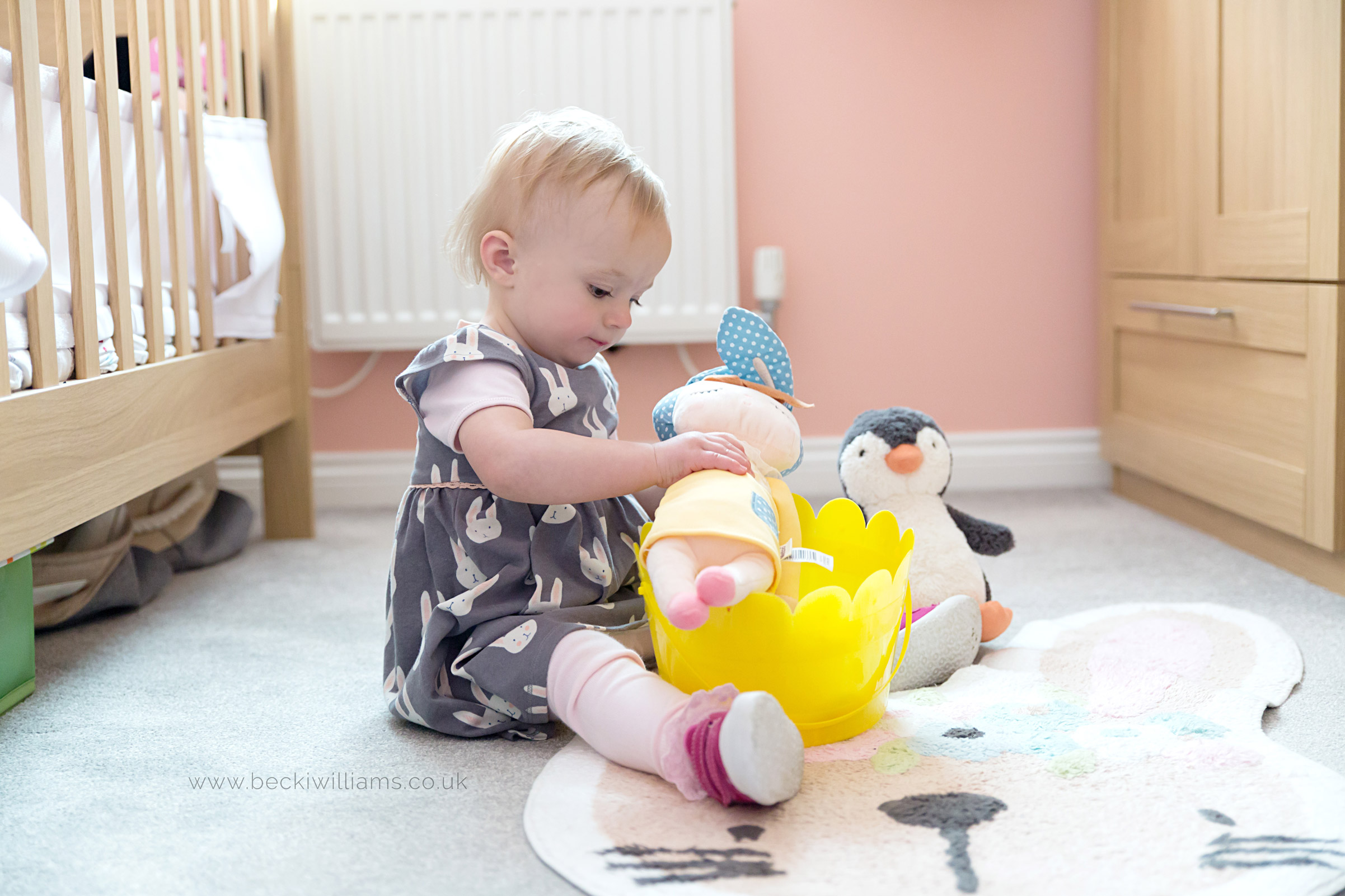 1 year old girl playing in her nursery in luton