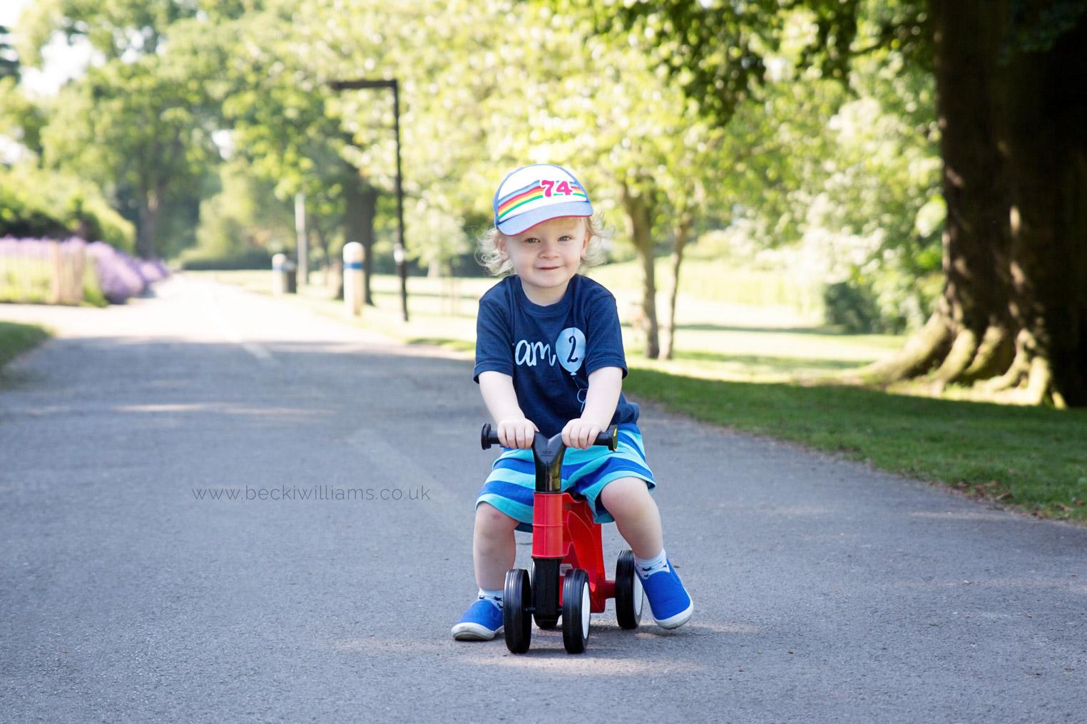 professional photography of 2 year old boy on his bike in gadebridge park, hemel hempstead