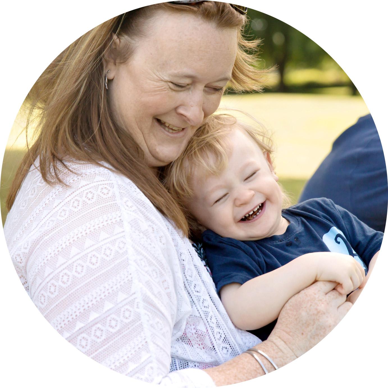mum hugs 2 year old son at professional photo shoot in hemel hempstead