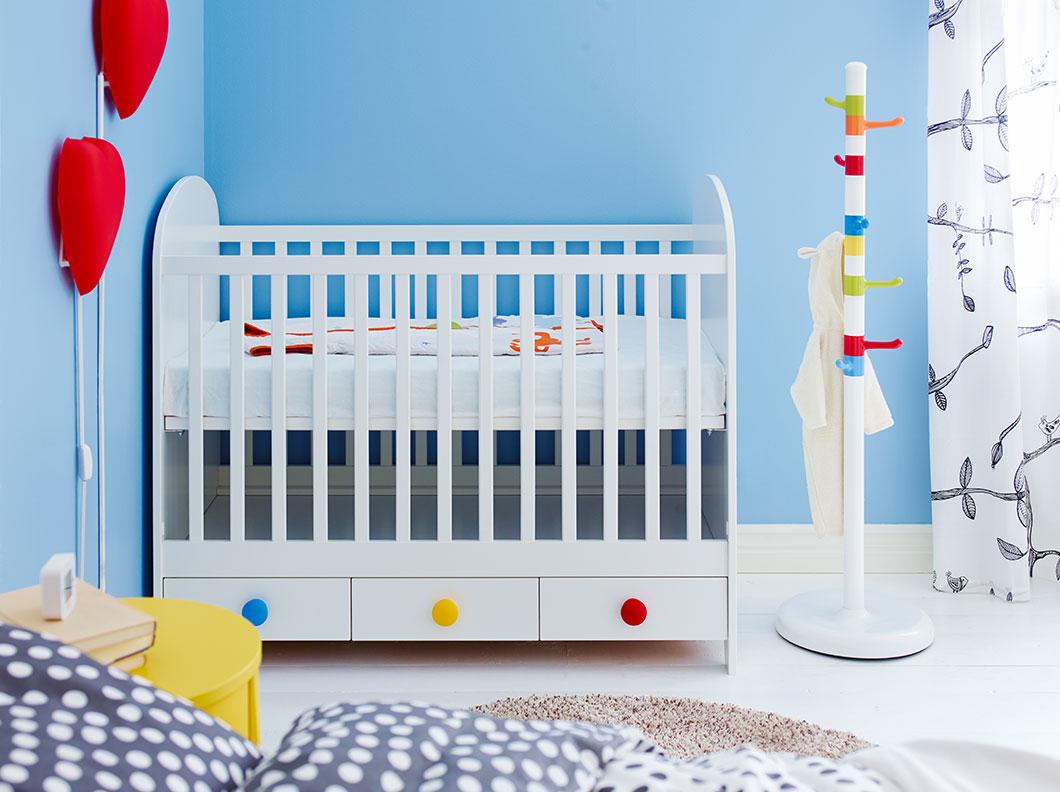 Ikea gonatt cot for a colourful nursery