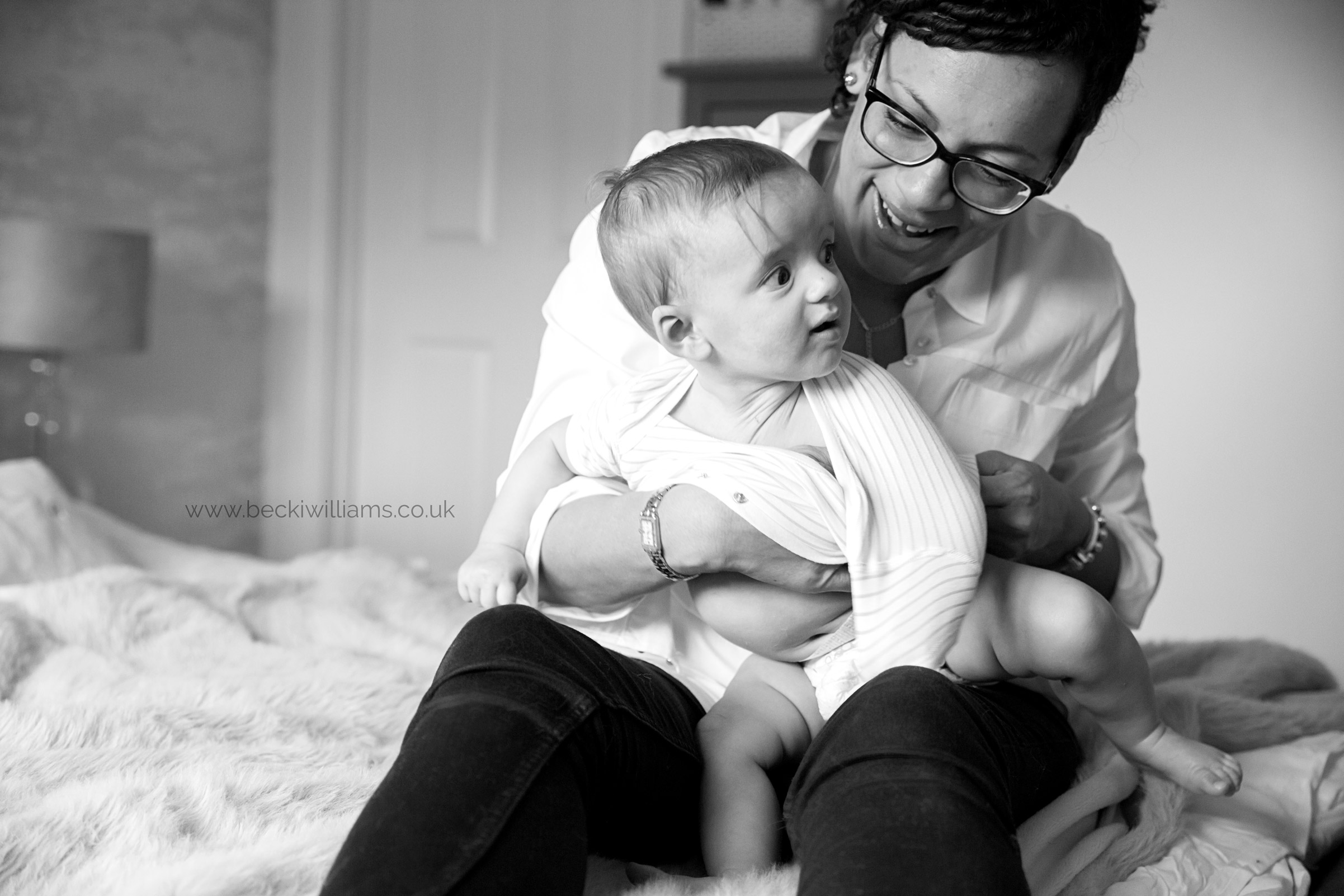 6 month old being changed by mum for natural baby photography in hitchin