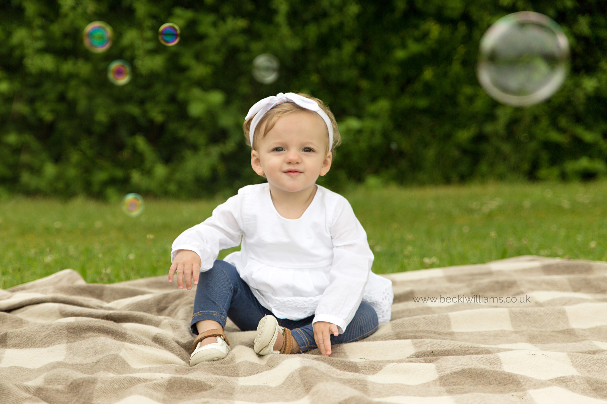 1 year old baby plays with bubbles in pirton, hitchin