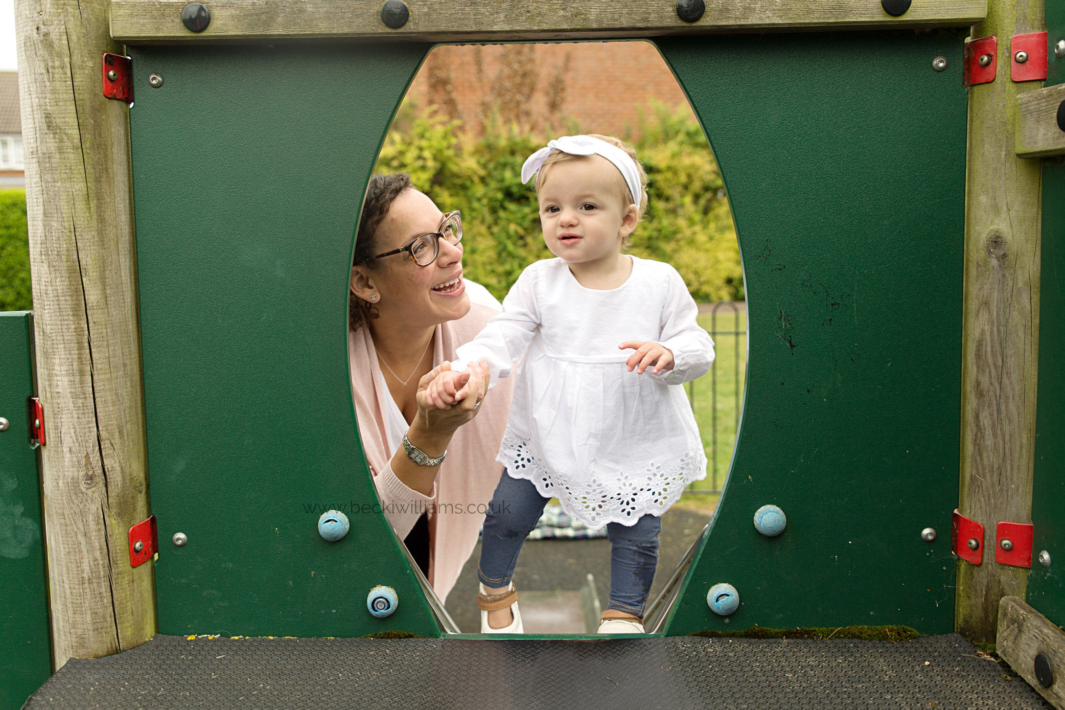 1 year old with mum in a park, playing