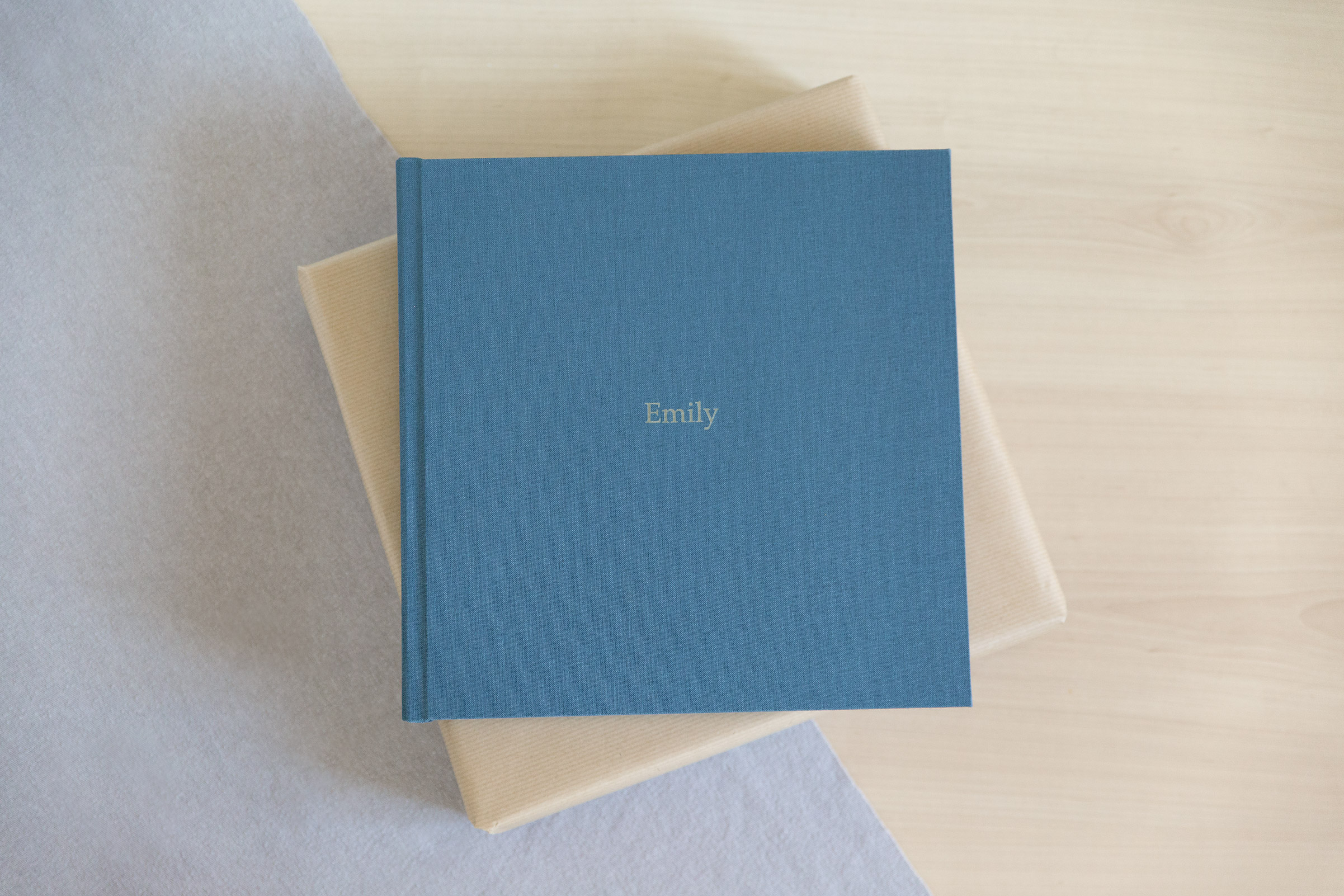 newborn baby photography professional album covered in blue linen