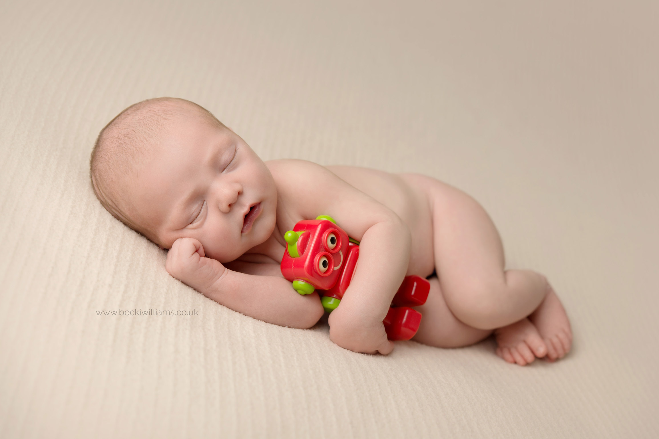 newborn-baby-photo-shoot-hemel-hempstead-robot-toy-cute.jpg