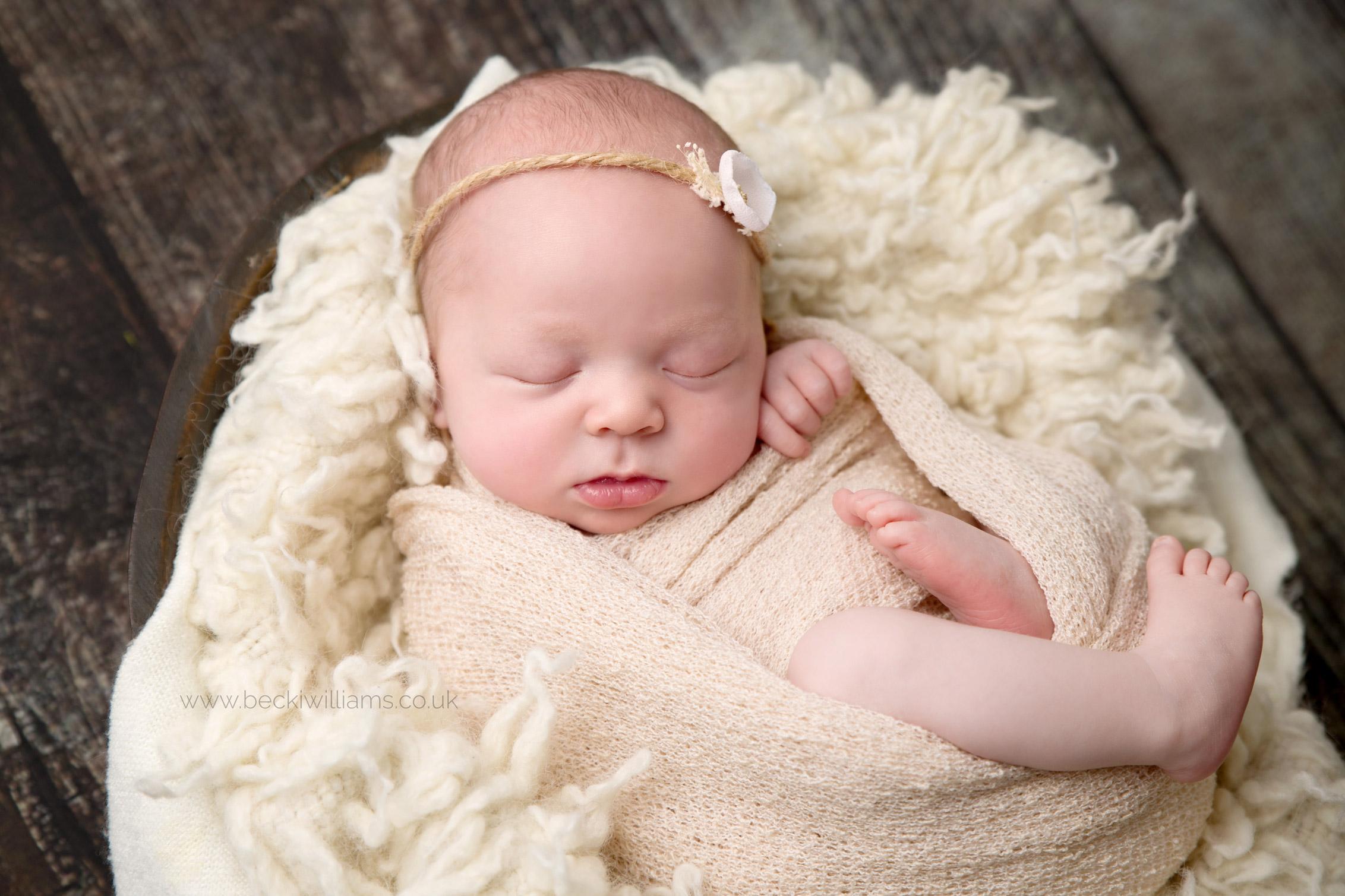 newborn-photography-hemel-hempstead-wrapped-cream-cute-prop-asleep.jpg