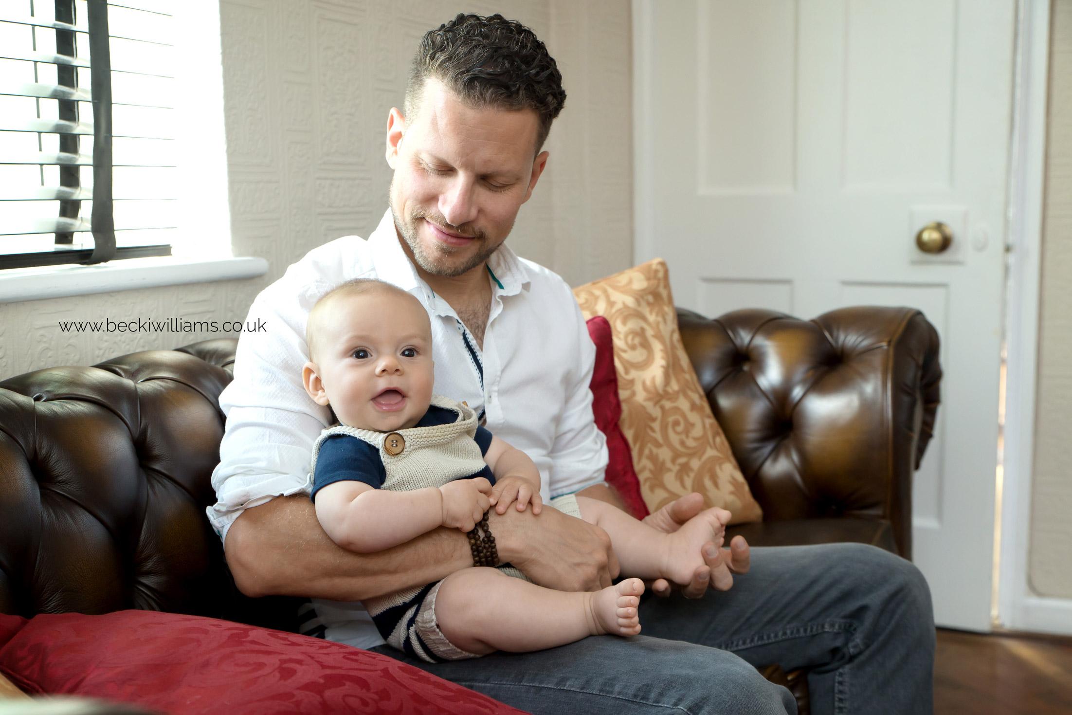 newborn-photographer-edgware-baby-dad-relaxed.jpg