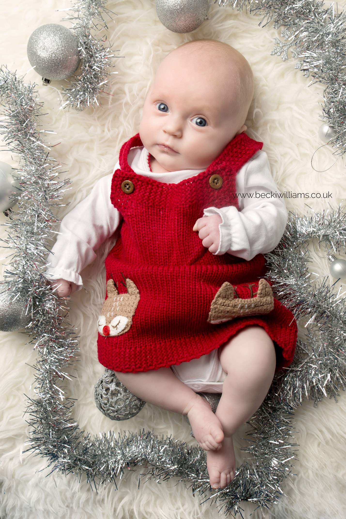 Christmas photo of a 2 month old baby