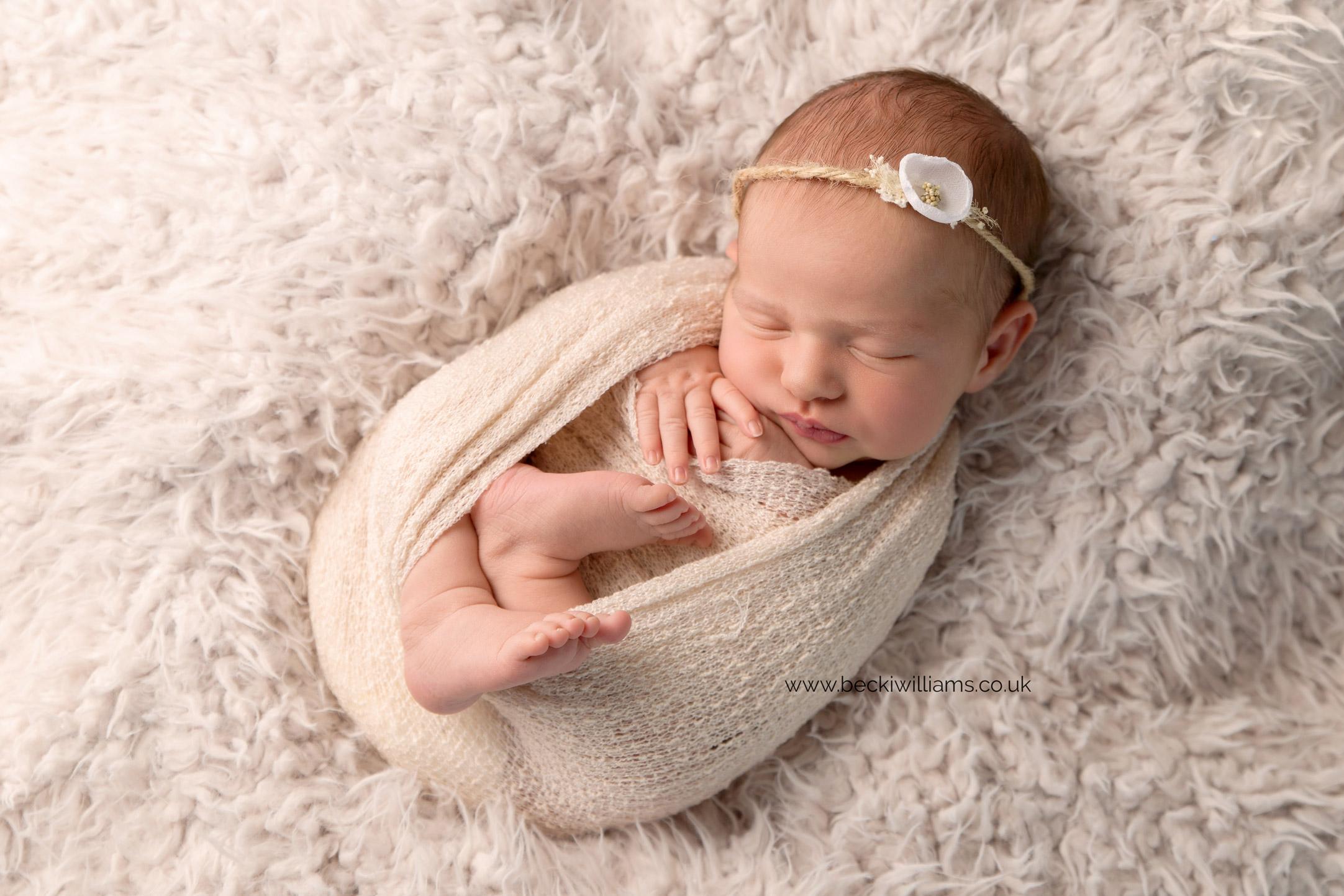 newborn-Hertfordshire-photograher-cute-asleep-wrapped-neutral-headband.jpg