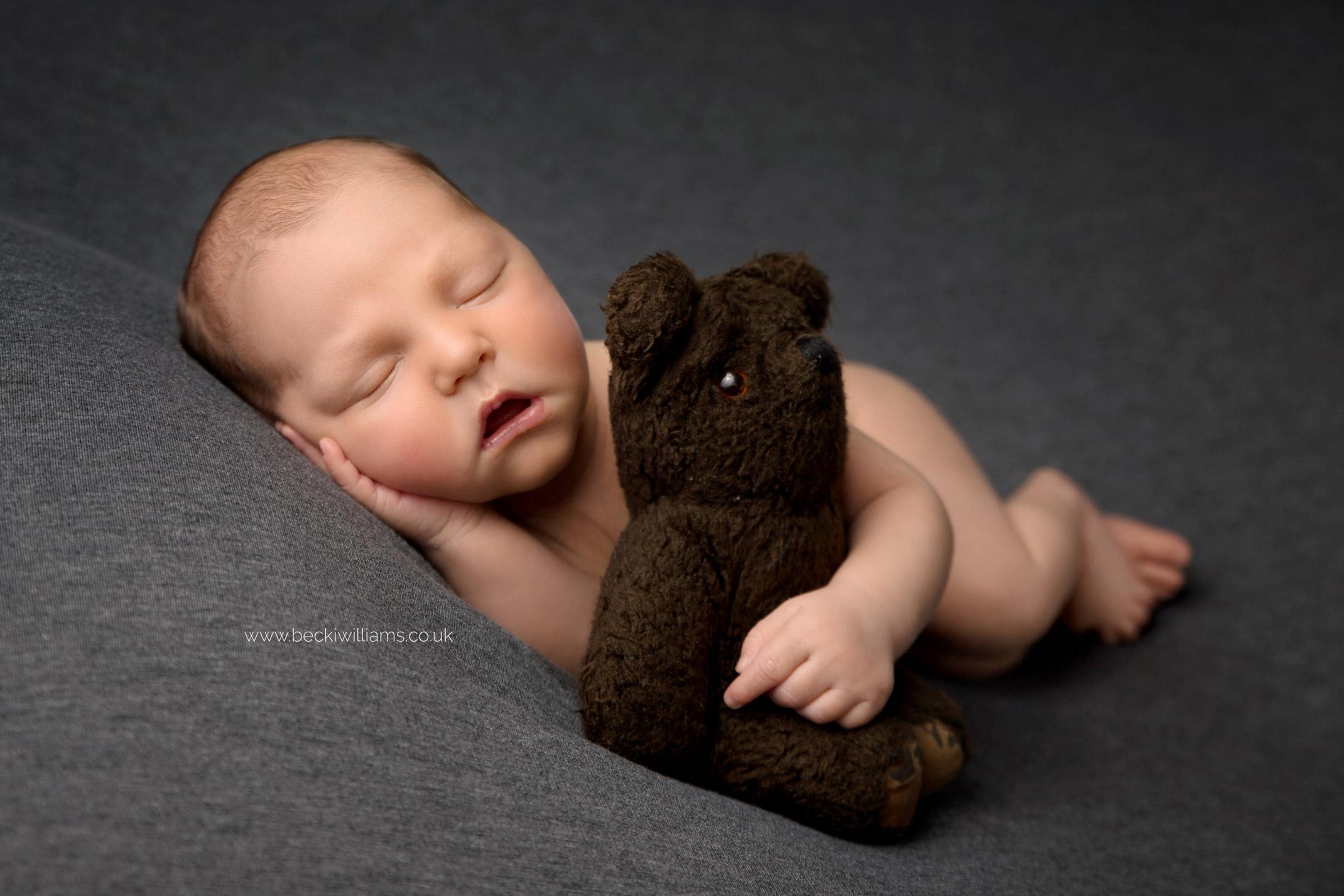 newborn-photographer-in-hertfordshire-boy-cute-asleep-bear.jpg