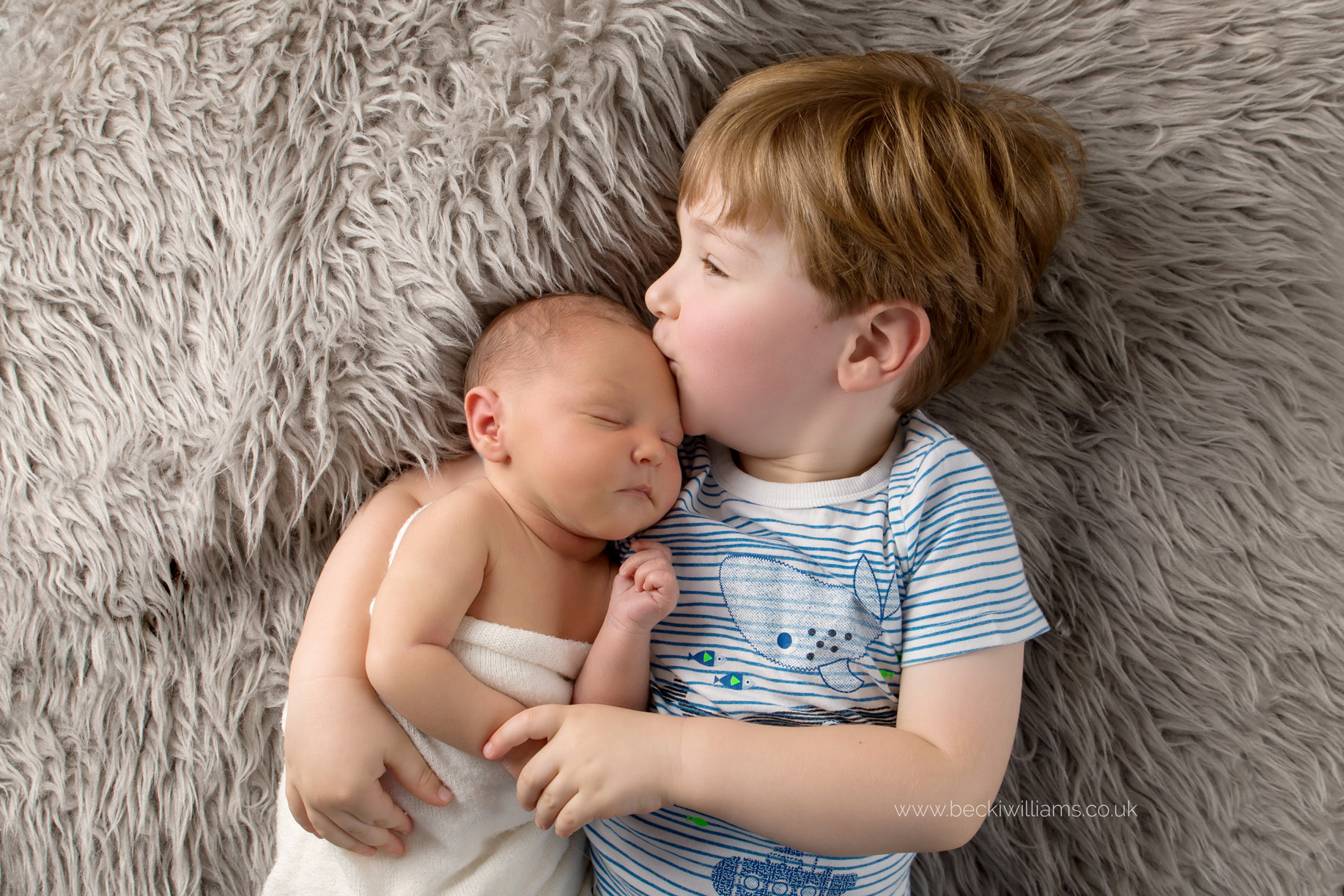 newborn-photographer-in-hertfordshire-boy-cute-asleep-sibling.jpg