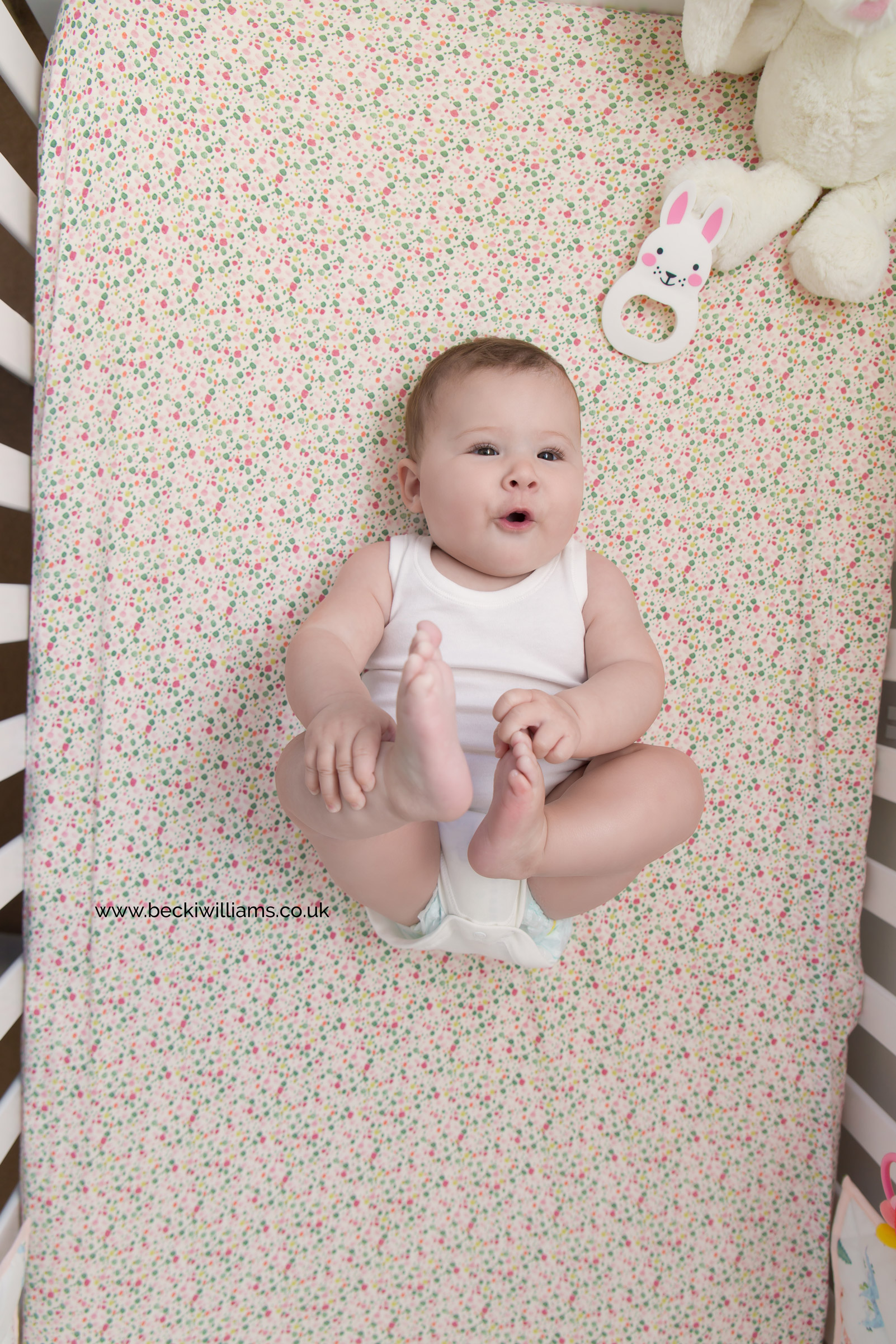 baby-photography-6-month-in-hertfordshire-girl-natural-at-home-cot.jpg