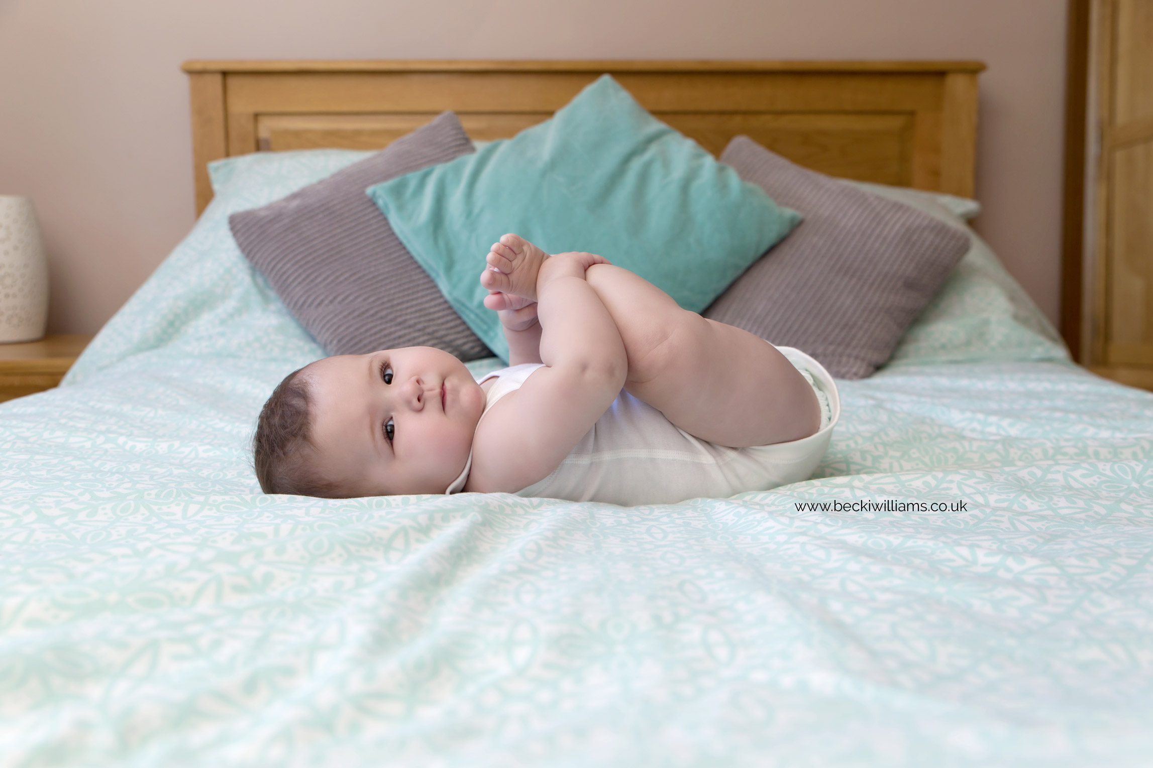 baby-photography-6-month-in-hertfordshire-girl-natural-at-home-bed.jpg