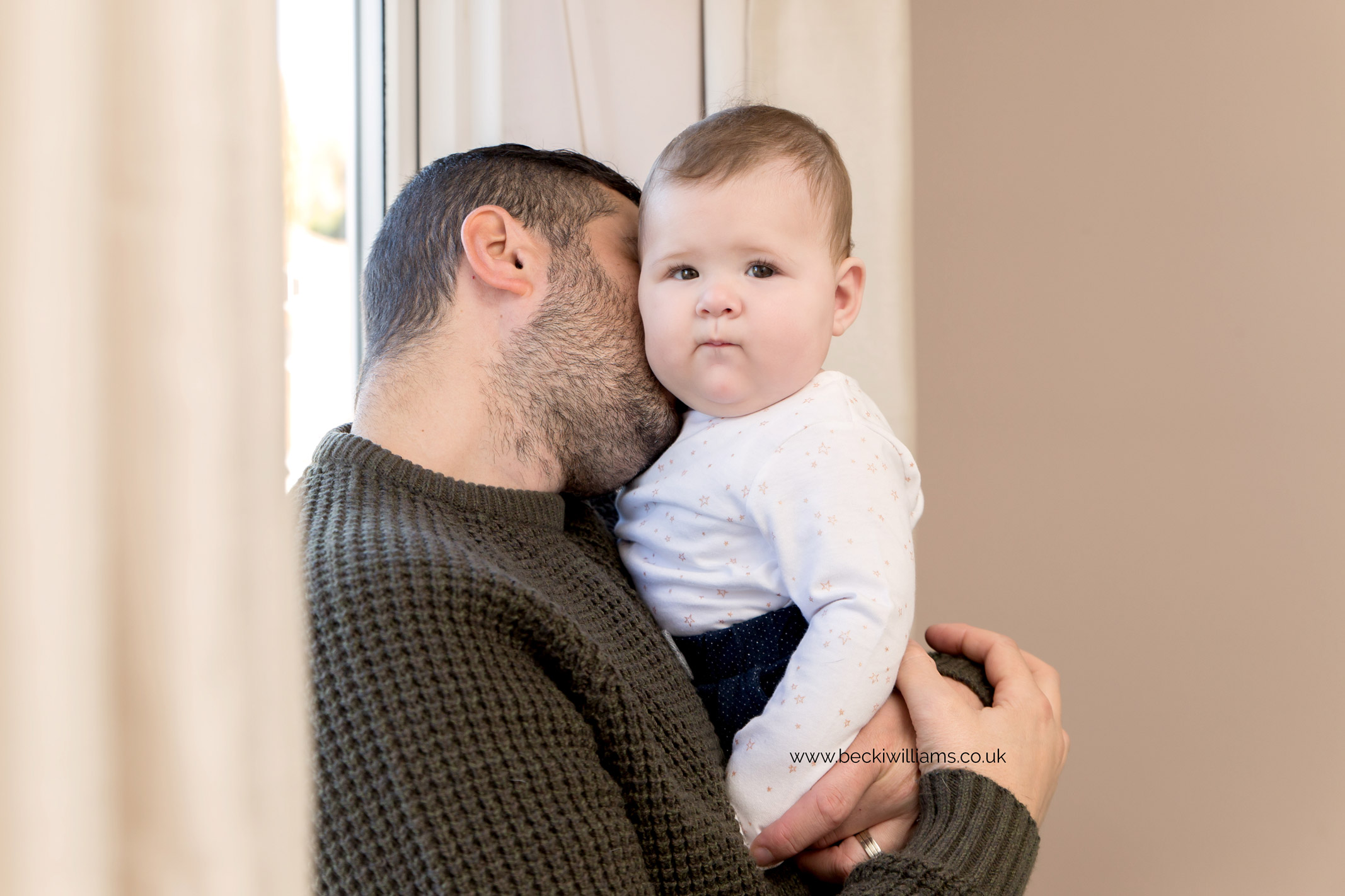 baby-photography-6-month-in-hertfordshire-girl-natural-at-home-dad-cuddles.jpg